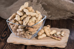 Peanuts in a bowl. Some Peanuts in a bowl against rustic wooden background stock photos