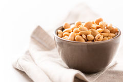 Peanuts in a bowl on tablecloth horizontal Stock Photos