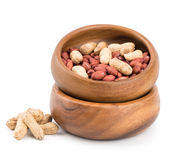 Peanuts in a bowl on a white background. Royalty Free Stock Photos