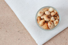 Peanuts on Calico and Wooden Royalty Free Stock Images