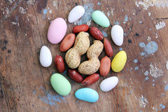 Peanuts with candies Stock Photography