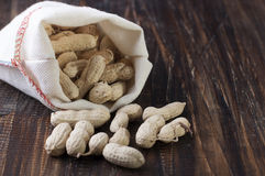 Peanuts in a canvas bag stock photos