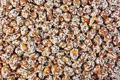 Peanuts in caramel with sesame texture Stock Photography