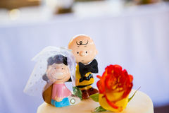 Peanuts Charlie Brown Wedding Cake Topper. SPRINGFIELD, OR - JULY 5, 2014: Charlie Brown Peanuts cake topper on a wedding cake at a reception Royalty Free Stock Images