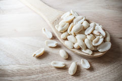 Peanuts closeup on wood ladle Royalty Free Stock Photo