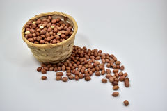 Peanuts. In the cloth bags on white background Stock Image