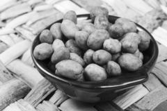 Peanuts coated full in the bowl in a bar stock photos