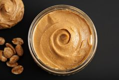 Peanuts and Fresh Peanut Butter Isoalted Black Background Protein Super Food Snack. Peanuts and Fresh Peanut Butter Isoalted Black Background Protein Super Food stock photography