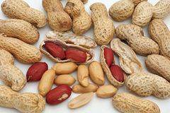 Peanuts, fruits and seeds Stock Images