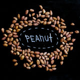 Peanuts full of proteins and fats. Diet and healthy lifestyle. top view. Ingredients for a healthy meal on a background of black school board stock image