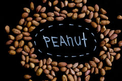 Peanuts full of proteins and fats. Diet and healthy lifestyle. top view. Ingredients for a healthy meal on a background of black school board stock photography