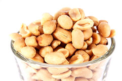 Peanuts in a glass. Some Peanuts in a glass isolated on white background stock images