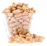 Peanuts in a glass. Some Peanuts in a glass isolated on white background stock image