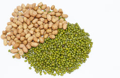 Peanuts and green mung beans  and white background Royalty Free Stock Photos