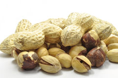 Peanuts and Hazelnuts on white. Nuts on a white background Royalty Free Stock Images