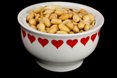 Peanuts in a heart bowl Stock Photography