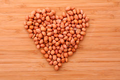 Peanuts in heart simbol Royalty Free Stock Photo