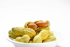 Peanuts isolated on the white background. Close up in blow. stock photo
