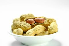 Peanuts isolated on the white background. Close up in blow. royalty free stock photography