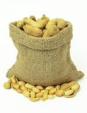 Peanuts in linen sack on white background. Stock Images