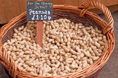 Peanuts in a market basket Stock Photos