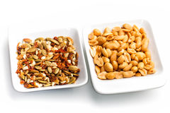 Peanuts mixed dried shelled fruit and dried tomatoes in white container Stock Photo