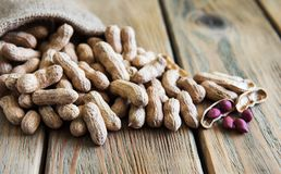 Peanuts in nutshell. On a old wooden table royalty free stock image