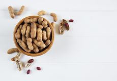 Peanuts in nutshell. On a old wooden table royalty free stock photo