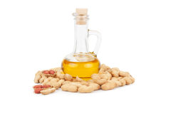 Peanuts and oil in bottle Royalty Free Stock Images