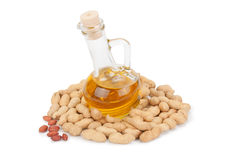 Peanuts and oil in bottle Stock Image