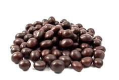 Peanuts Or Almonds Covered With Chocolate Stock Images