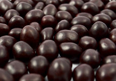 Peanuts Or Almonds Covered With Chocolate Royalty Free Stock Image