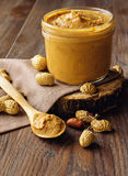 Peanuts and peanut butter on wooden background Royalty Free Stock Images