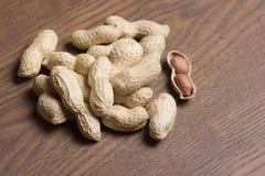 Peanuts , Peanuts background. Peanuts seed. Vignette peanuts texture. Brown peanut. Peanut material. Royalty Free Stock Photos
