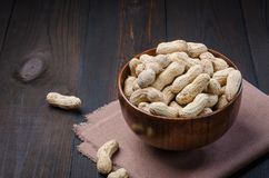 Peanuts in the peel on a dark background. stock photos