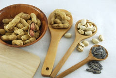 Peanuts pistachio nuts and sunflower seeds Stock Photos