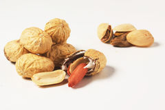Peanuts and pistachios. On a white background Royalty Free Stock Images