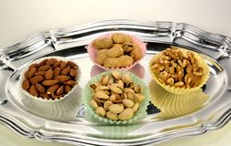 Peanuts, pistachios, almonds and walnuts. Stock Photos