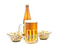 Peanuts, pistachios and beer Stock Images