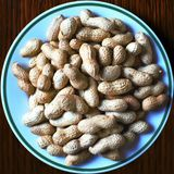 Peanuts on a plate stock photography