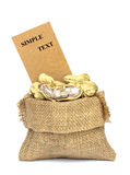 Peanuts and price tag in burlap bag on white Stock Images