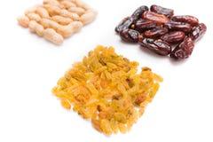 Peanuts, raisins and dried halawi Royalty Free Stock Images