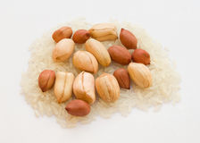Peanuts and rice. Healthy raw peanuts and rice Stock Images