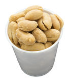 Peanuts salted shelled sample cup isolated Stock Image