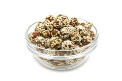 Peanuts with sesame seeds in a glass Royalty Free Stock Images