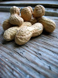 Peanuts in the shell. On an old retro window sill royalty free stock photos