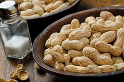 Peanuts in the Shell. A bowl of peanuts in the shell with salt shaker Royalty Free Stock Image