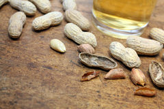 Peanuts in shell with beer Stock Photo