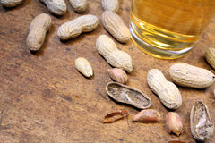Peanuts in shell with beer Royalty Free Stock Images
