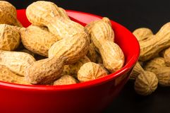 Peanuts in shell on dark background, close up. Peanuts, Arachis hypogaea, in shell on dark background, close up, selective focus Stock Photo